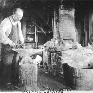blacksmith working as a locksmith